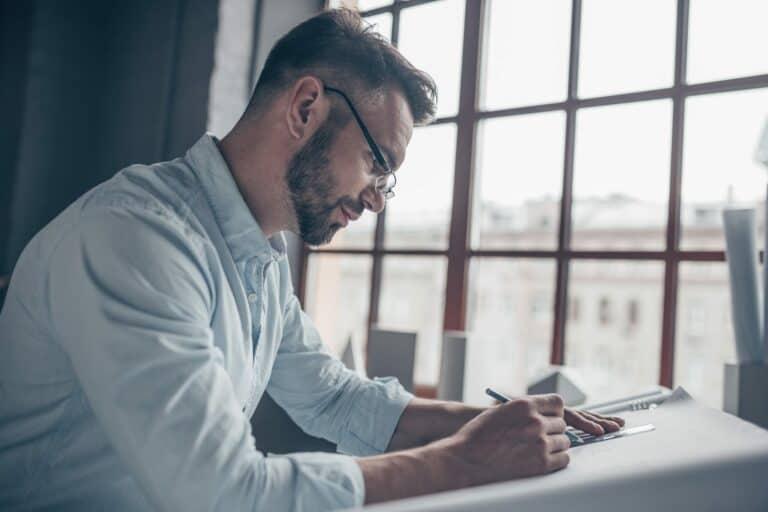 Writing man at work